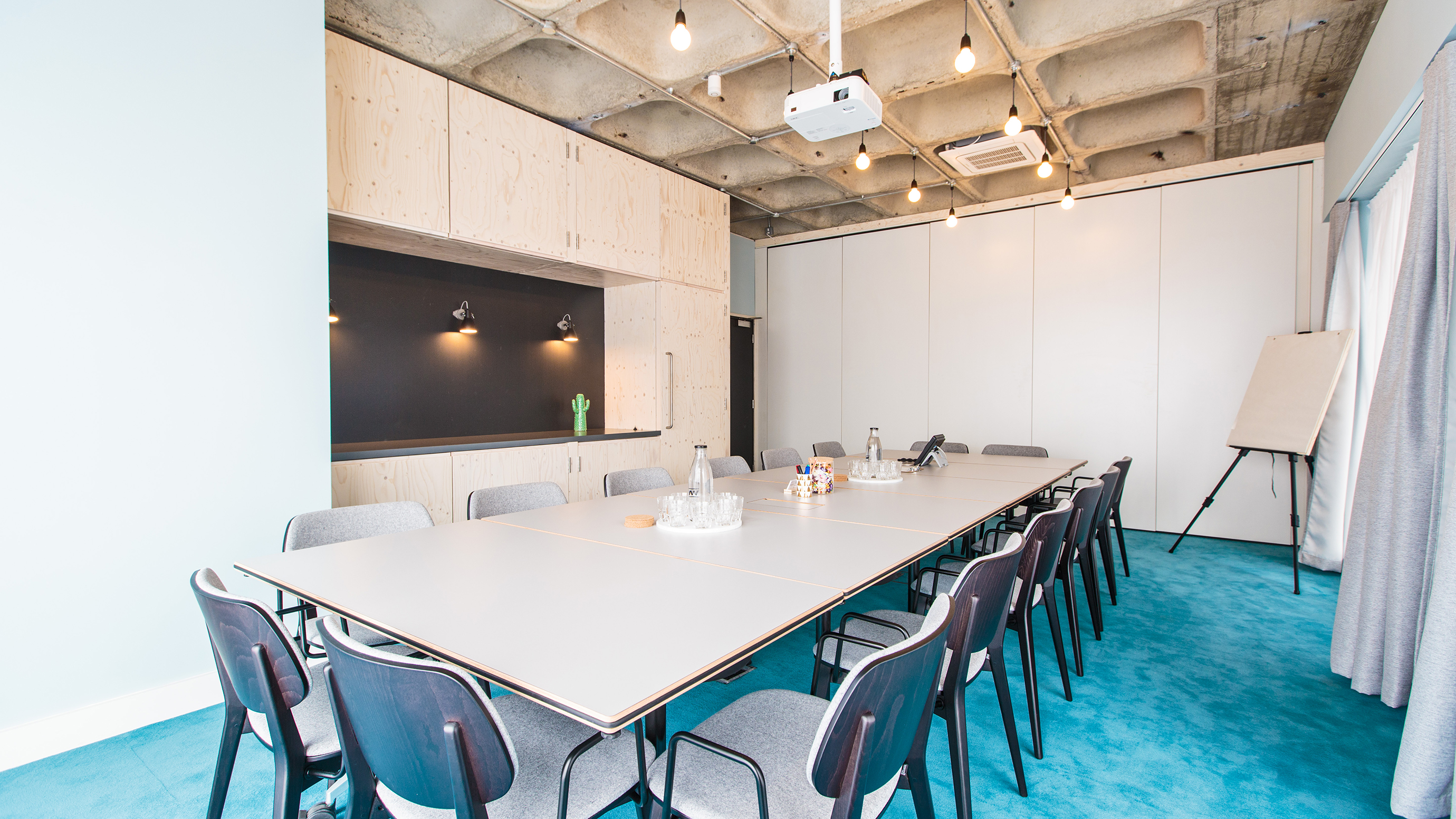 Large meeting room with rectangular table and grey chairs at TOG building 201 Borough High Street London