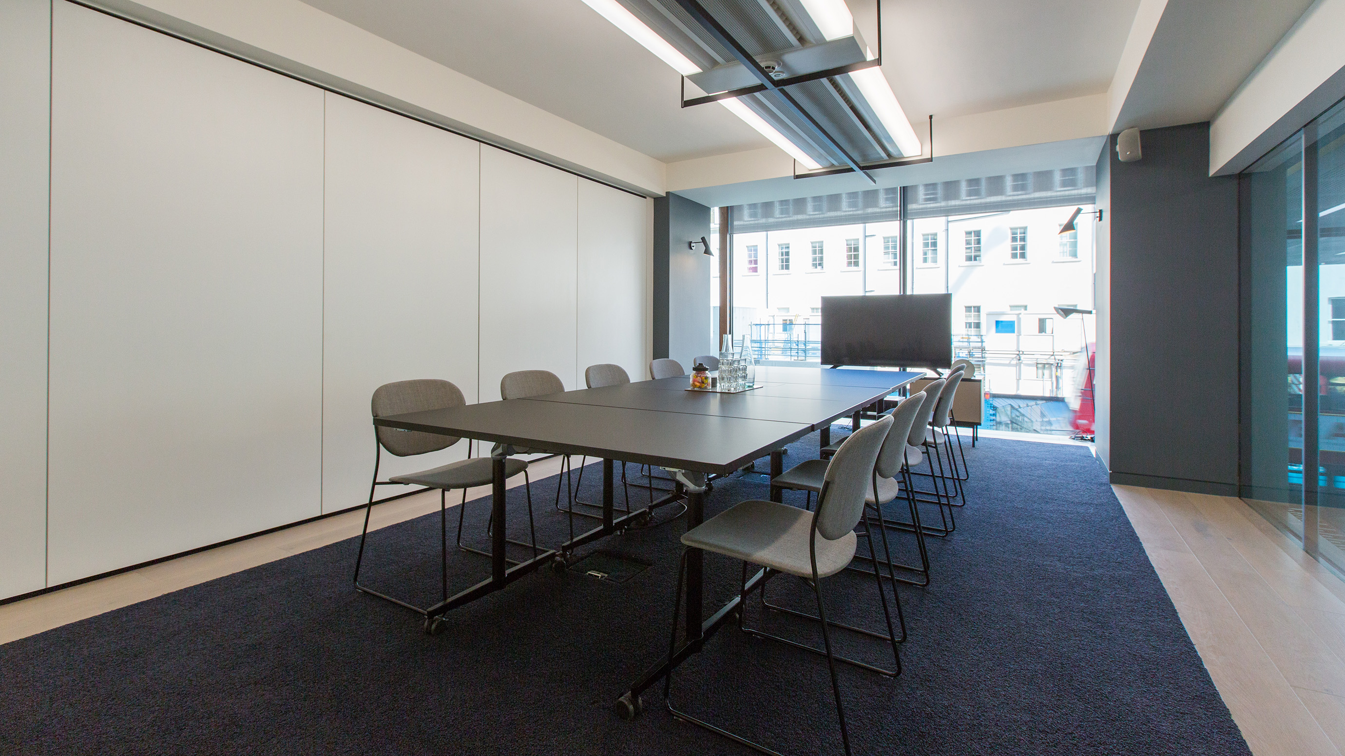 Medium meeting room with black table and grey chairs at TOG building 20 Eastbourne Terrace London