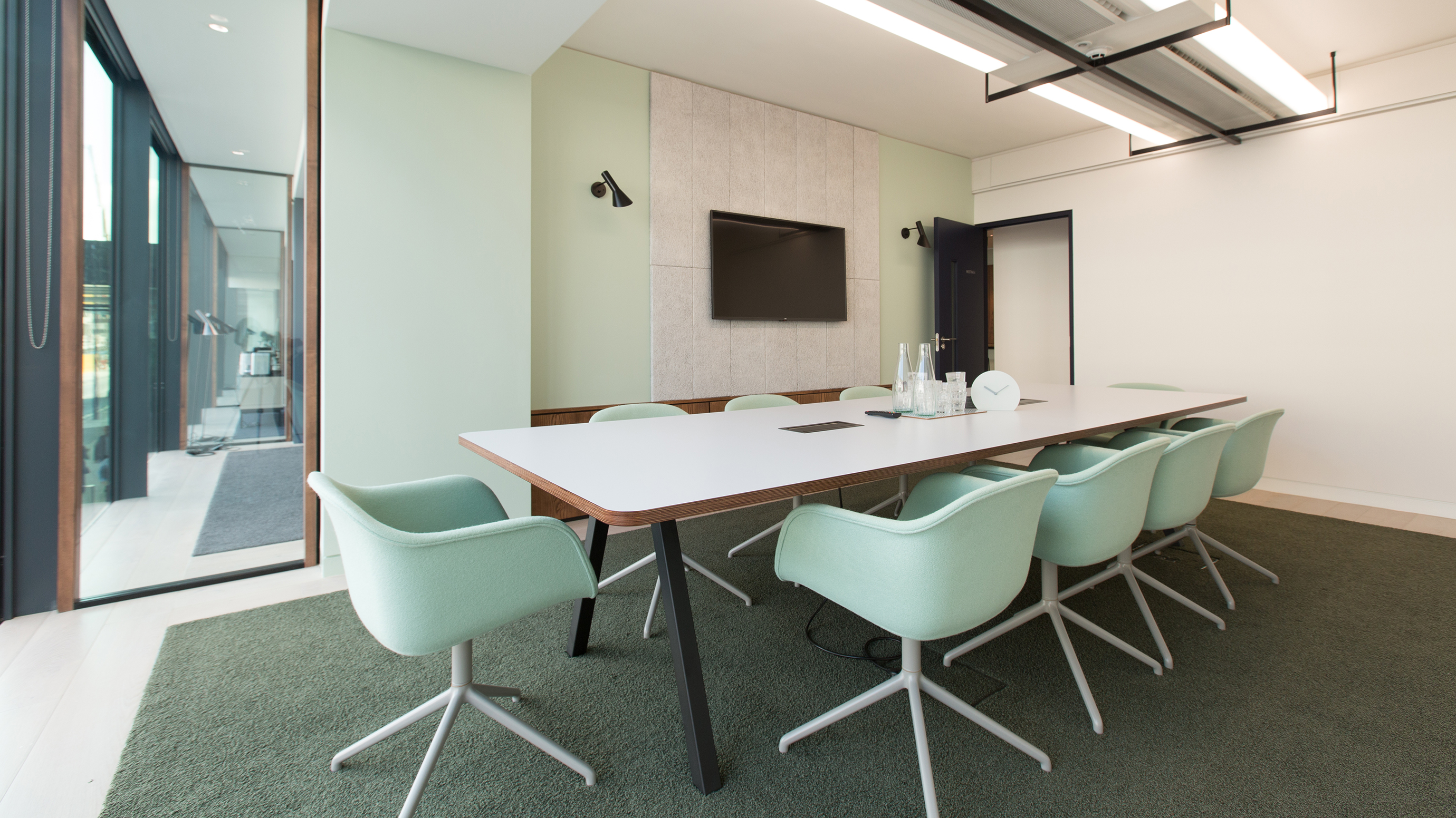 Medium meeting room with white table and mint green chairs and tv screen at TOG building 20 Eastbourne Terrace London