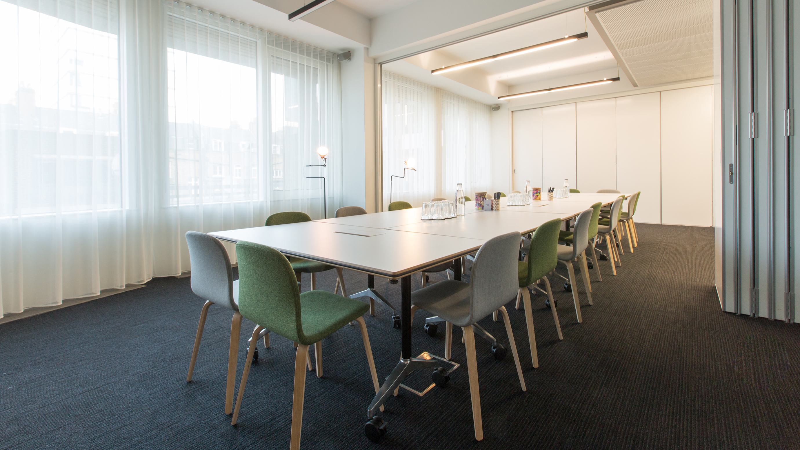 Medium meeting room with white table and grey and green chairs at TOG building 2 Stephen Street London