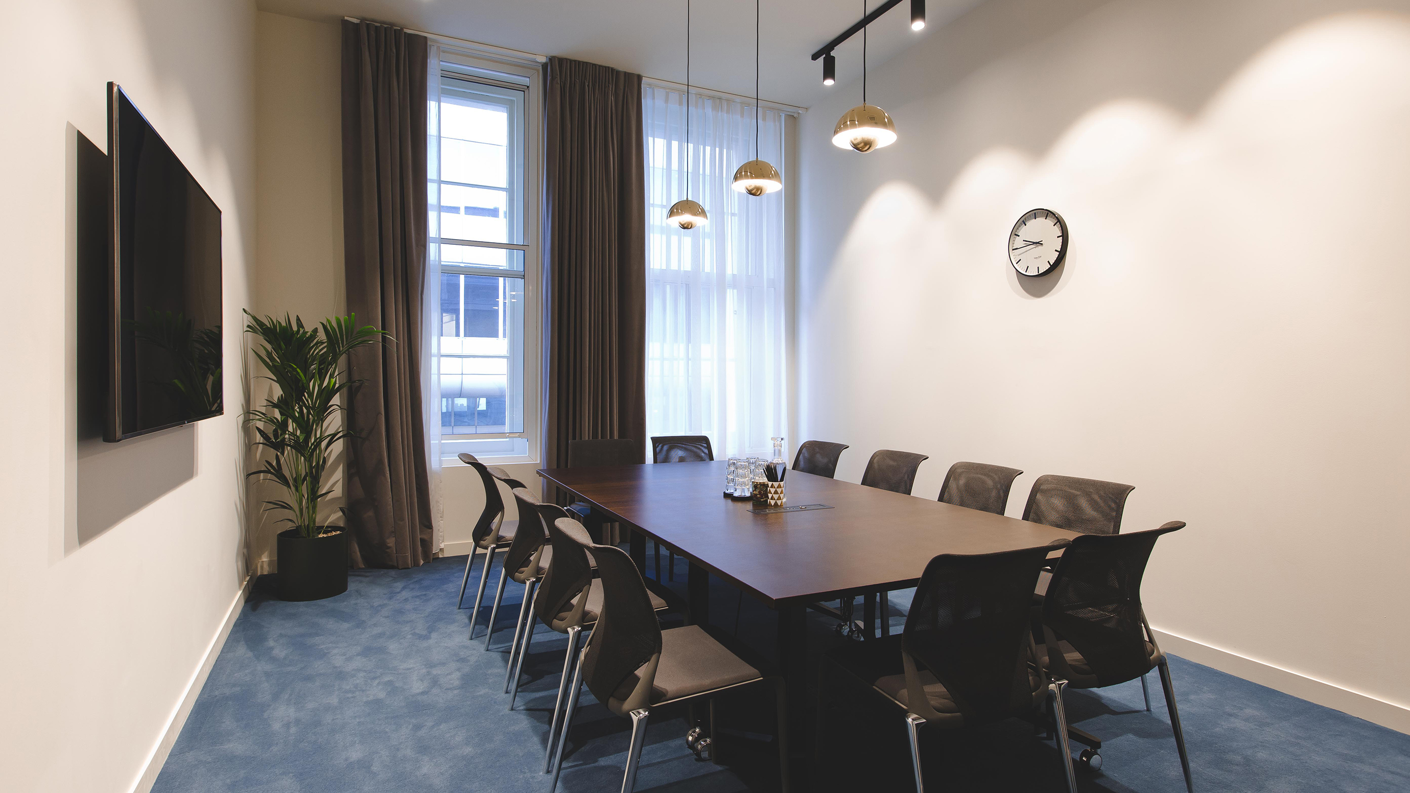 Medium meeting room with dark wooden table and chairs and tv screen at TOG building Belle House London