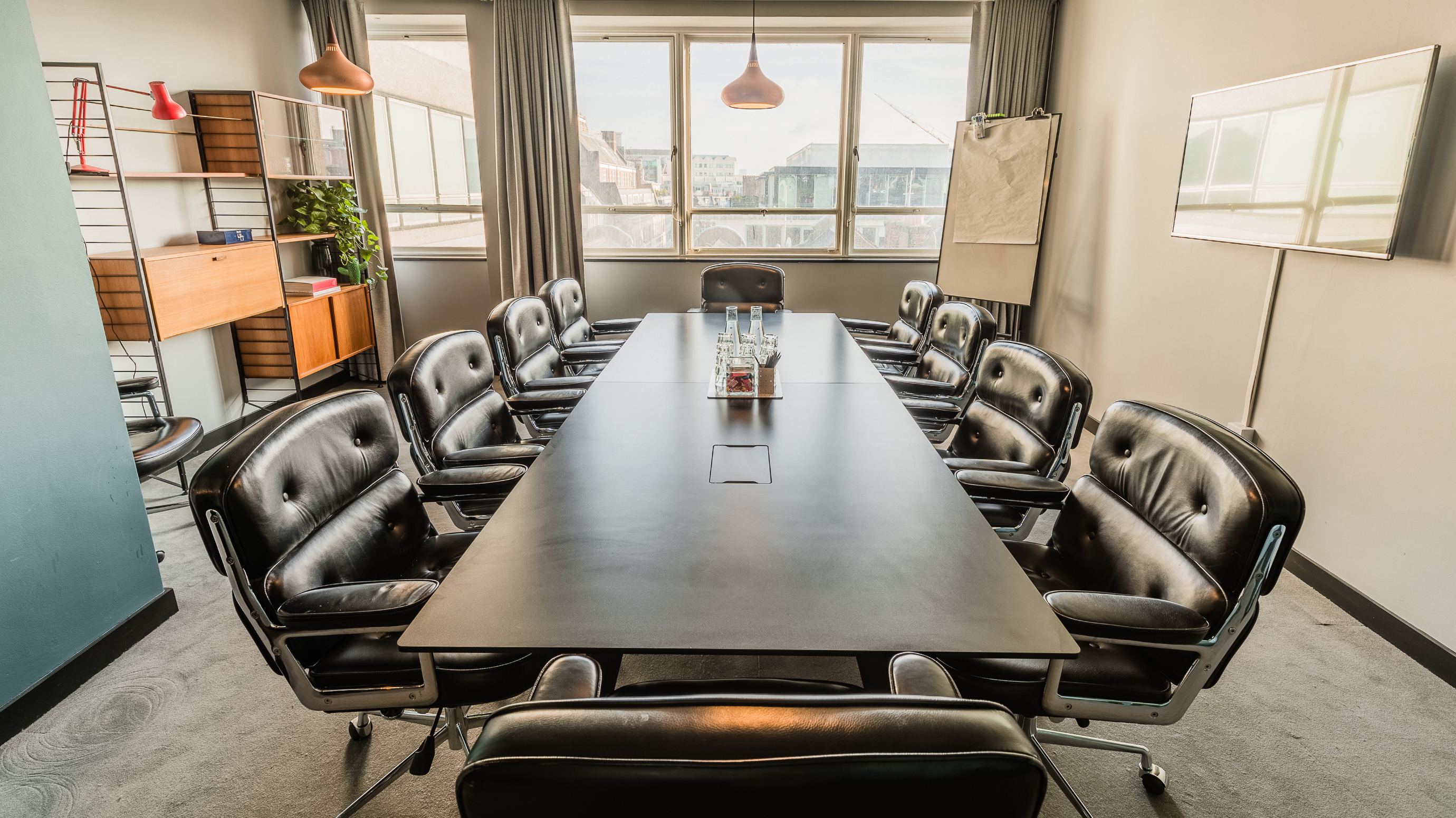 Medium meeting room with rectangular black table and leather chairs at TOG building Henry Wood House London