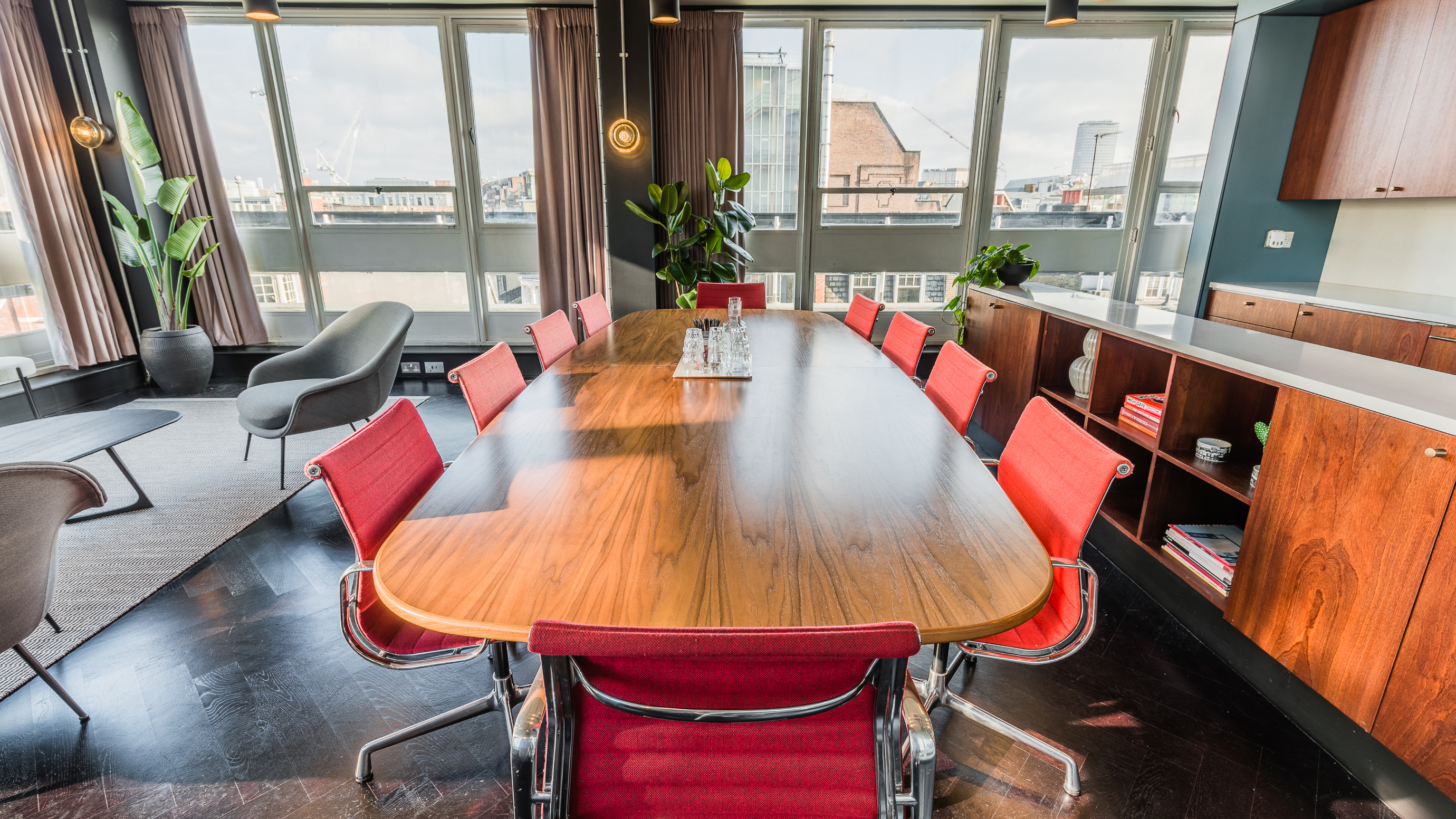 Penthouse medium meeting room with wooden table and red chairs at TOG building Henry Wood House London