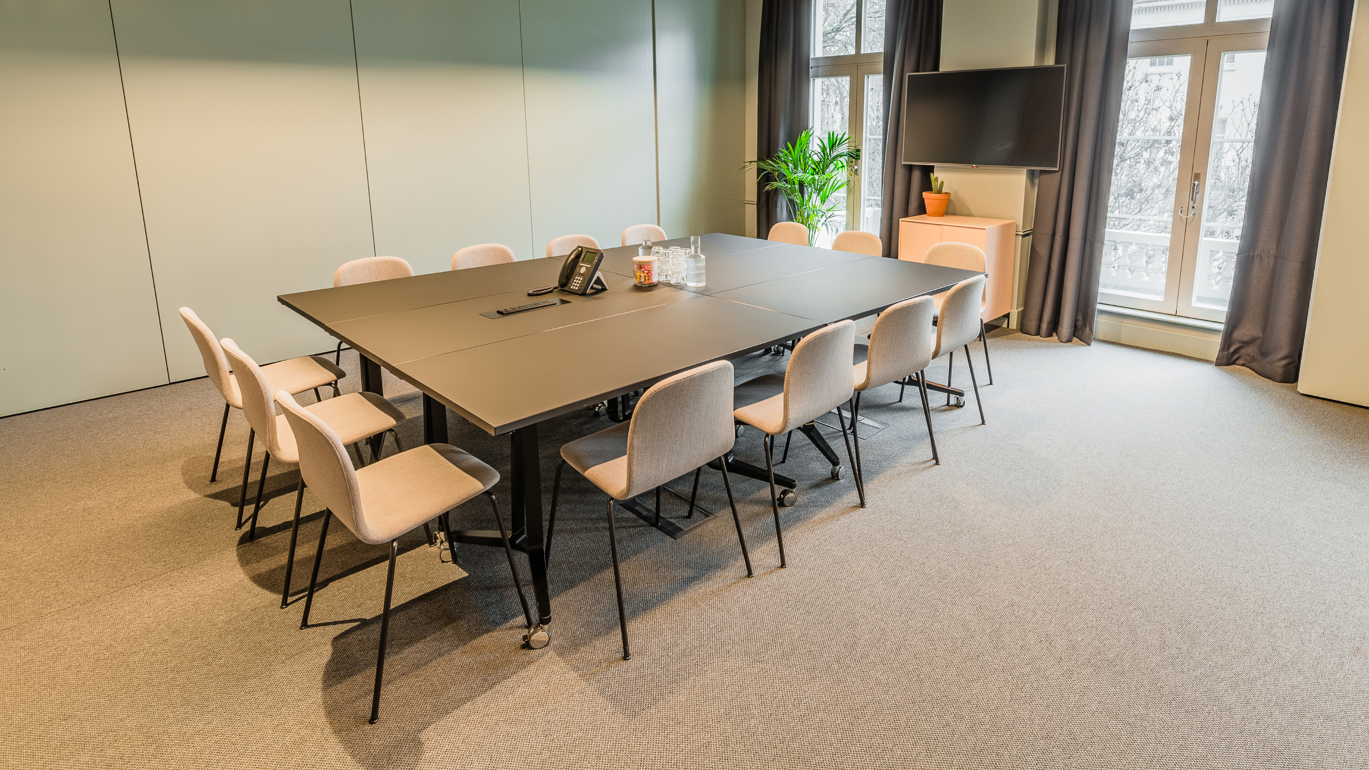 Medium meeting room with dark table and pale chairs and carpet at TOG building Thomas House London