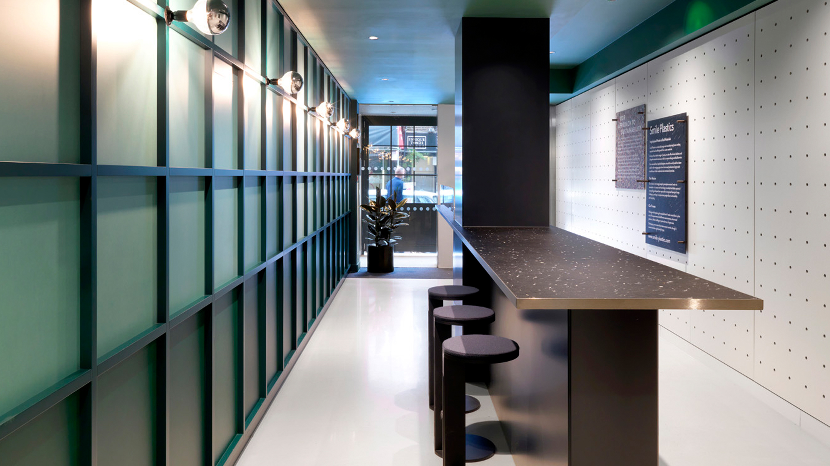 Large island with stools in ground floor reception area at TOG building Wardour Street Soho