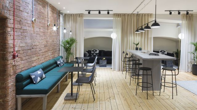 Large co-working space with sofas and stools at TOG building at 24 Greville Street London