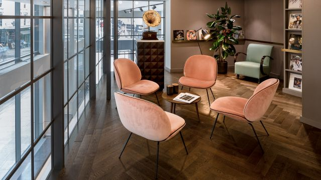 Chairs with small circular table breakout area TOG Bloomsbury Building Holborn