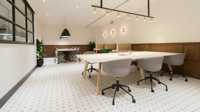 Two large tables with seating for 6 in coworking space at TOG building Warnford Court City of London