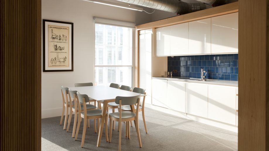 Bright and airy kitchen with table and chairs at TOG building at 19 Eastbourne Terrace Paddington London