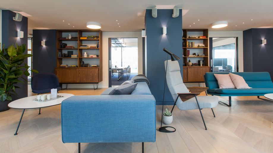 Stylish lounge with blue decor at TOG building at 20 Eastbourne Terrace London Paddington
