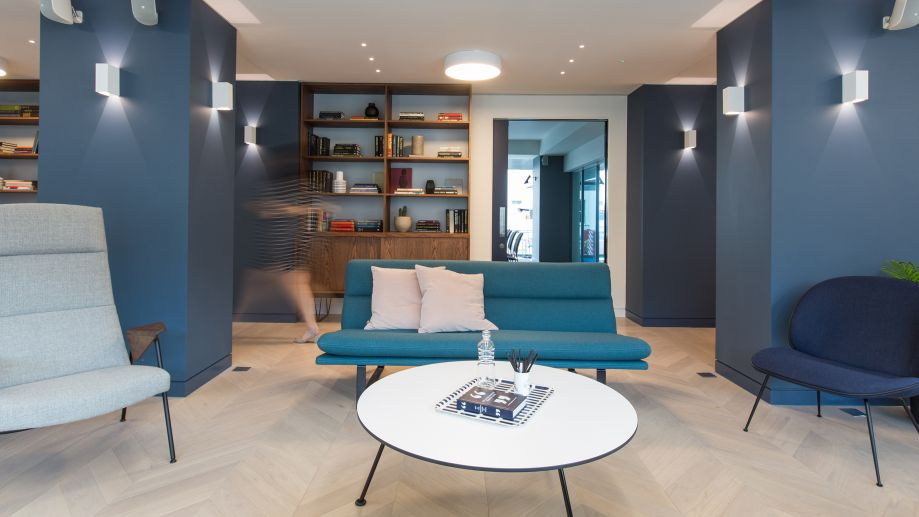 Stylish blue lounge area at TOG building at 20 Eastbourne Terrace London Paddington