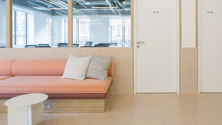 Large peach sofa in lounge at TOG building at 2 Angel Square London