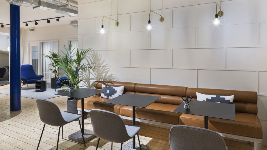 Co-working space with leather sofa and aztec design cushions at TOG building at 24 Greville Street London