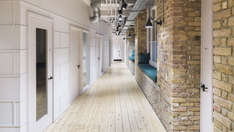 Focus booths opposite brick interior and teal benches at TOG building at 24 Greville Street London