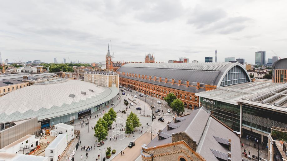 Expansive view of London's King's Cross and St Pancras railway stations from the Gridiron Building roof terrace.