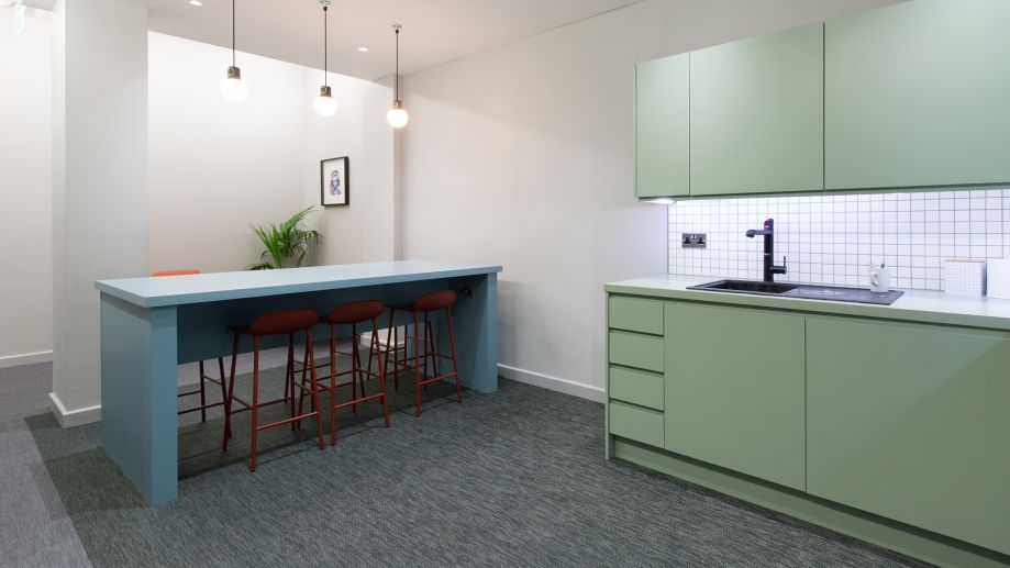 Kitchen with breakfast bar and red stools at TOG building 81 Rivington Street