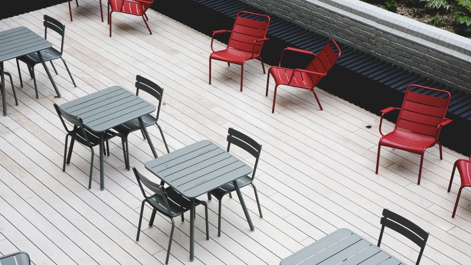 Tables and chairs in terrace area at TOG Thomas House building Victoria