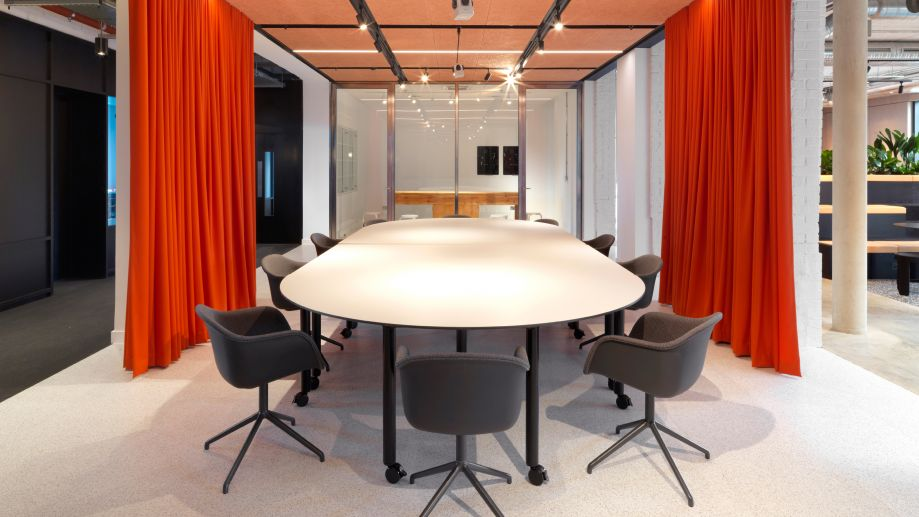 Large oval table with seating for 10 in coworking space at TOG Tintagel House building Vauxhall
